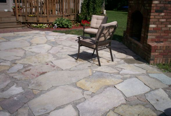 Flagstone patios provide a unique and rustic look for your outdoor space