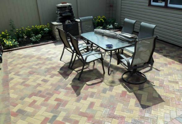 Colorful herringbone patio design